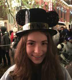 My daughter wearing a Mickey mouse hat at Disneyland